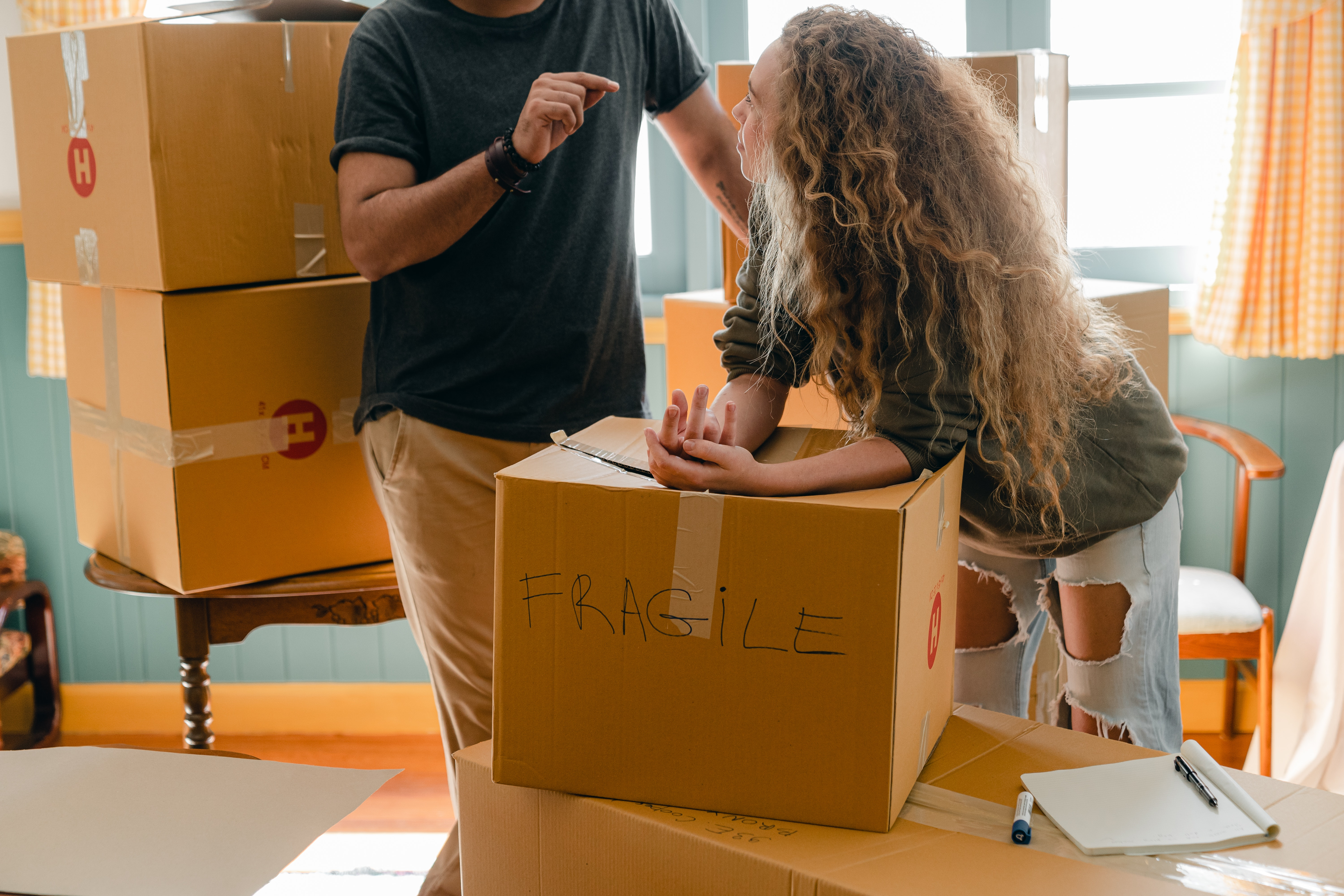 woman-and-crop-boyfriend-near-different-boxes-for-moving-4246205